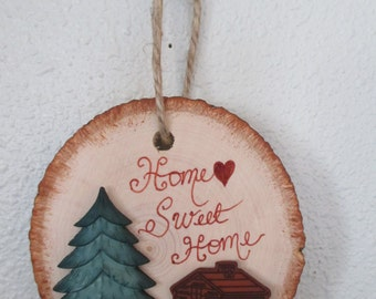 Home Sweet Home Cabin wall hanging or ornament, Log wooden background with tree and cabin