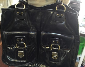 Vintage Brown Leather purse, pocket detail much like a famous designer, double handle, lots of pockets, from high end store