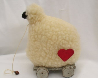 Primitive/Folk art handmade Sheep on wheels