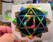 "Heart Chakra Symbol. Sticker. Decal.  Prismatic Rainbow Gold/ Emerald Sparkle Vinyl. 3.75"" size."