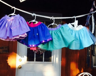 4 Princess Party Aprons-sold together In any of these sizes. 2/3/4/5/6 Rapunzel, Anna, Ariel, Elsa