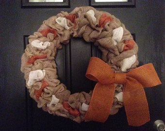Neutral burlap wreath with peek-a-boo orange and white