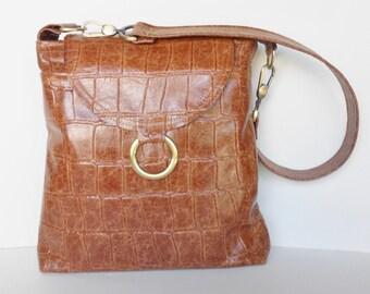 Leather shoulder bag, or crossbody bag, in brown embossed crocodile.