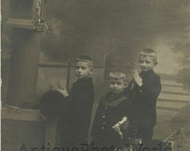 Praying boys posing with toy horses strange antique private rppc photo