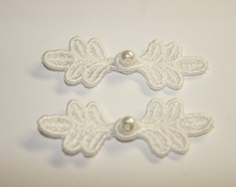 """1 3/4"""" Small Frog Closures, pkg of 2. WHITE #R02. Machine Embroidered."""