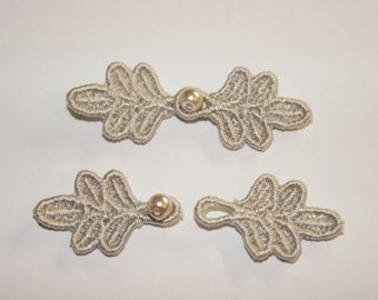 """1 3/4"""" Small Frog Closures, pkg of 2. BEIGE #R24. Machine Embroidered."""