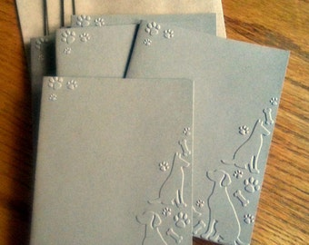 Set of 6 embossed dogs, paws and bones note cards