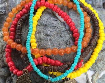 Beaded stretch bracelets.  Boho hippie stack bracelets. Set of 5.