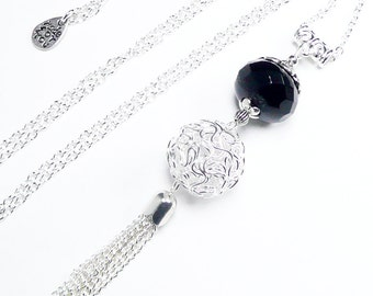 Long pendant necklace, silver colored jewelry, long pompom pendant, black faceted beaded necklace,