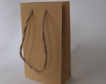 Small natural brown paper bags.Natural handles . PK. of 10 bags
