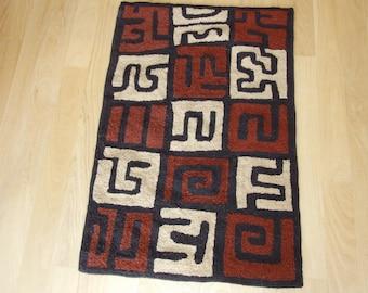 """Hand hooked area rug or wall hanging, """"Kuba"""""""