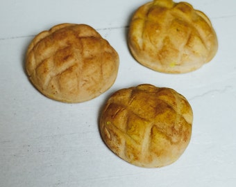 Three Round Loaves of Bread