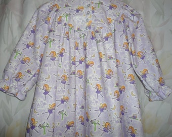 Girls Size 7 Pajamas witlh purple fairies with orange hair on lilac and white back ground.