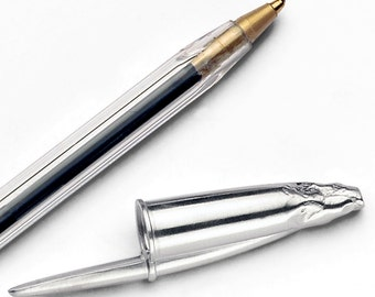 Capuchón y tapón de bolígrafo