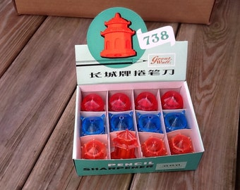 1970's dime store box of pagoda building pencil sharpeners.