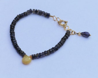 beautiful gemstone bracelet with faceted Iolite, opal and gold plated clasp