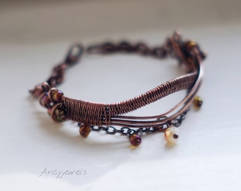 Copper wire wrapped bracelet with glass beads