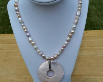 Thank you, Posieden for your gifts from the sea! Pearl and silver necklace with shell focal.