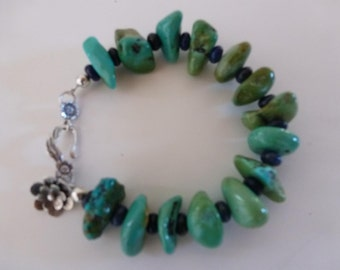 South by Southwest Bracelet - polished bluegreen chunks of Kingman turquoise - smooth lapis rondelles - siver hook clasp - flower charm