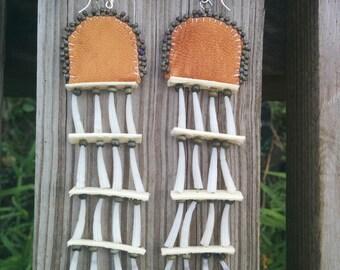Earrings dentalium shell, rawhid, glass beadse and leather