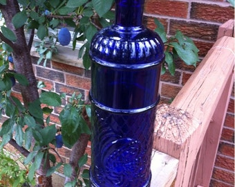 Cobalt Blue Glass Bottle.Decorative Collectible Cobalt Blue Glass Wine Bottle. Made in Canada.