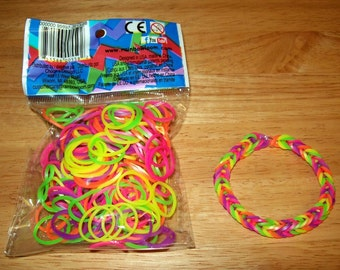 Rainbow Loom® Authentic Rubber Bands, Silicone Mixed Neon - 300-Band Package with 12 C-Clips and a FREE BRACELET!