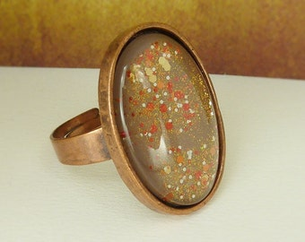 Ring adjustable copper oval glittering brown