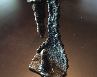 Welded steel stalagmite and stalactite