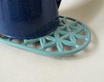 Vintage Cast Iron Powder Blue Trivet with Flower Motif