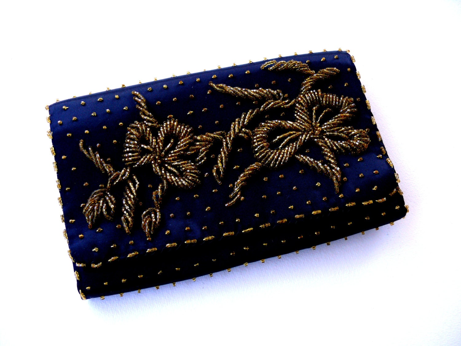We traveled to some of the most exotic locales and were inspired to create this clutch, featuring an enchanting arrangement of mixed-metallic beads.