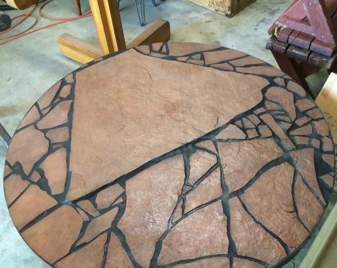 "Turbulence: a 39"" diameter 17"" tall stone topped folk art table"