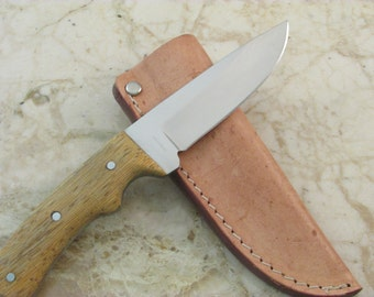 Drop Point Knife Blade (Lati wood handle with aluminum pins on handle)and a 9 oz. Leather  Sheath