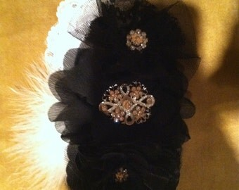 Black hair bow with feather accent