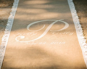 40 ft burlap runner. Lace border with monogram. Pretty! No backing. With backing 35.00 more.