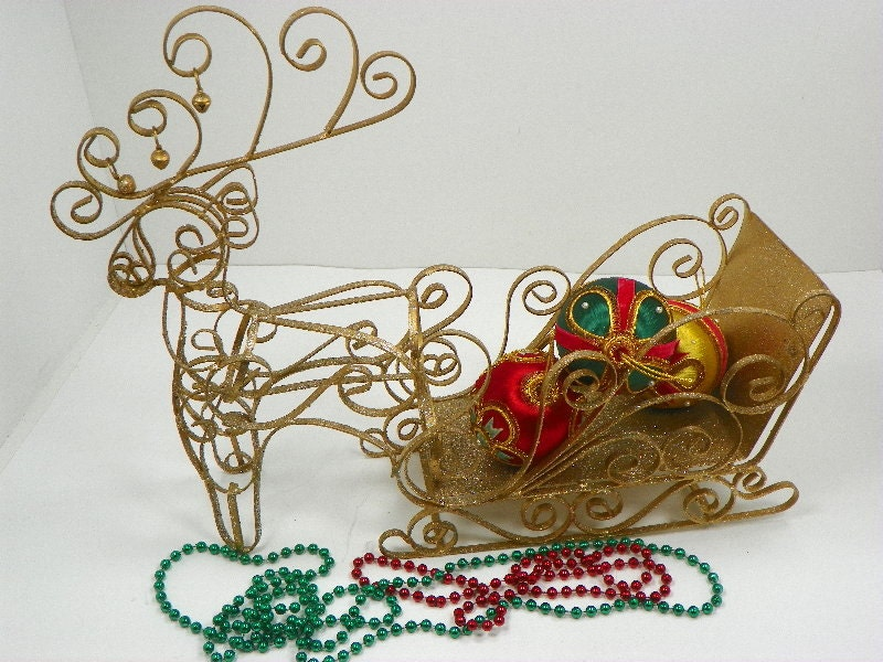 Large metal santa sleigh with reindeer gold glitter
