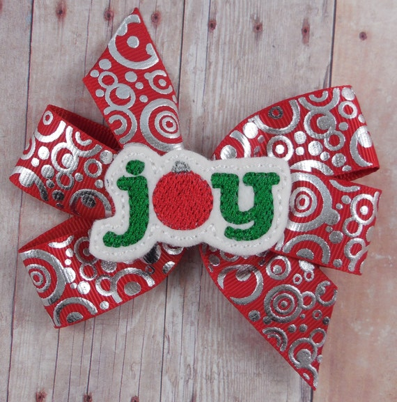 Joy pinwheel bow on partially lined alligator clip with no slip clip - Red with silver foil circles - approx. 4 inches across