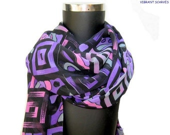 Multicolored, long, black, printed scarf in polyester chiffon.Gift ideas.