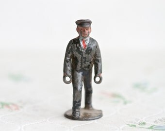 Cart Puller Man - Antique Lead Toy