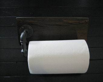 Industrial style wall mounted paper towel holder made with gas pipe and reclaimed wood