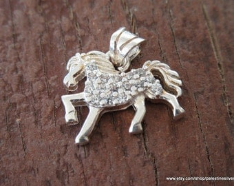 Silver pendant horse covered with shiny beautiful crystals