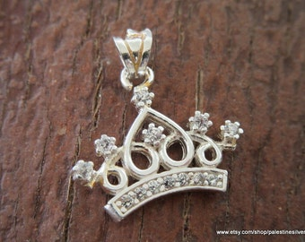 Silver pendant crown decorated with shiny beautiful crystals
