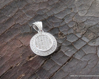 Silver pendant circular shape covered with shiny beautiful crystals