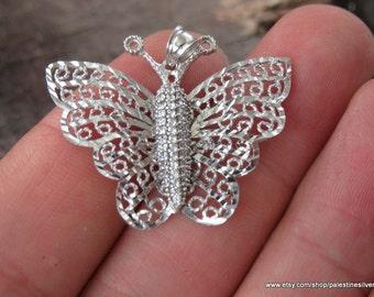 Shiny silver pendant butterfly shape