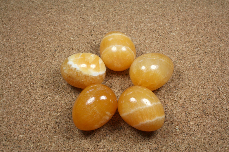 gemstone egg calcite egg orange and by abosbeads
