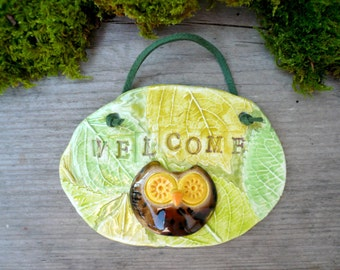 ceramic plate with embossed leaves written WELCOME and little OWL-ceramic plate with little OWL-tagged welcome