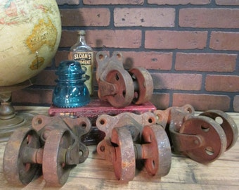 "Antique Vintage Industrial Double Wheel CastersSwivel Cast Iron #11 Set of Four Casters 4 1/2"" Tall 3 1/2"" Wheels from Old Cotton Mill Cart"