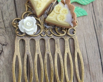 Two Slices of Miniature Dollhouse Sized Banana Creme Pie on a Small Brass Comb