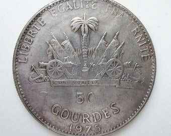 Interesting old replica coin - 50 Gourdes 1975