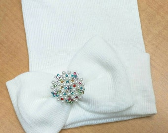Newborn Hospital Hat. White w/ Bow and topped with Multiple Color Rhinestones & Pearls. Beauitful New Baby Hospital Hat! Great Shower Gift!