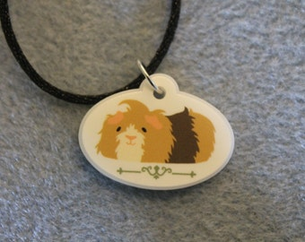 Ruffled Hair Guinea Charm